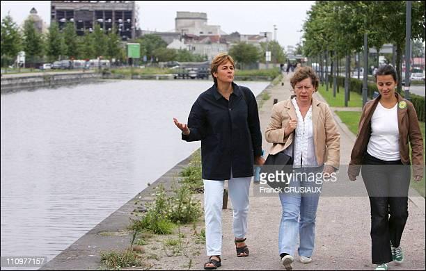 Dominique Voynet walks around the Canal de Roubaix with MarieChristine Blandin Senator 'Verts' and Cecile Duflot national spokesman of the 'Verts' in...