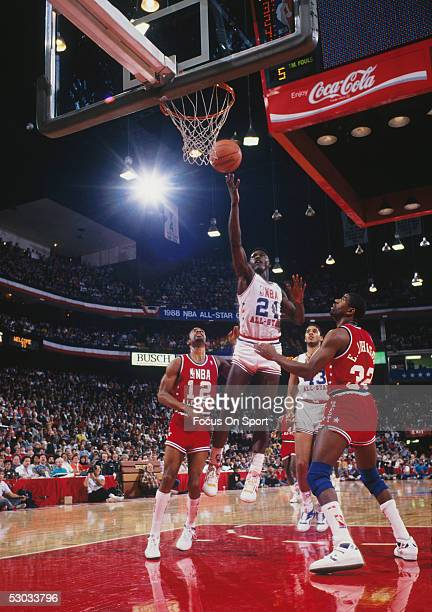 Dominique Wilkins jumps for a layup during an NBA All Star Game. NOTE TO USER: User expressly acknowledges and agrees that, by downloading and/or...