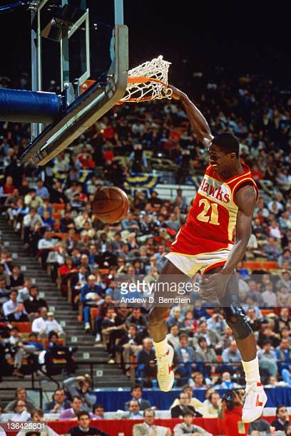 Dominique Wilkins of the Atlanta Hawks attempts a dunk during the 1985 Slam Dunk Contest circa 1985 at Market Square Arena in Indianapolis, Indiana....