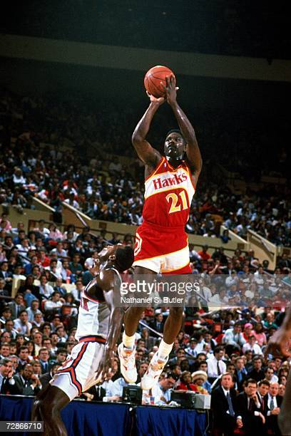 Dominique Wilkins of the Atlanta Hawks attempts a shot against the New York Knicks during a 1990 NBA game played at Madison Square Garden in New York...