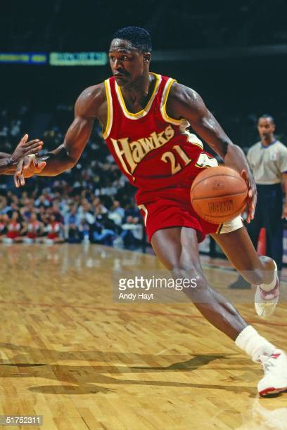 Dominique Wilkins of the Atlanta Hawks dribble drives to the basket against the Miami Heat during the NBA game on November 19, 1993 in Miami,...