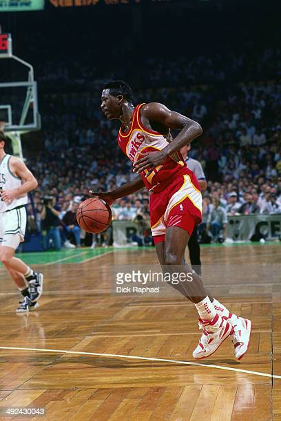 Dominique Wilkins of the Atlanta Hawks drives against the Boston Celtics during a game played in 1988 at the Boston Garden in Boston Massachusetts...