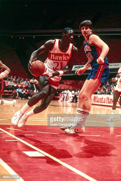 Dominique Wilkins of the Atlanta Hawks drives against the Detroit Pistonscirca 1982 at The Omni in Atlanta Georgia NOTE TO USER User expressly...