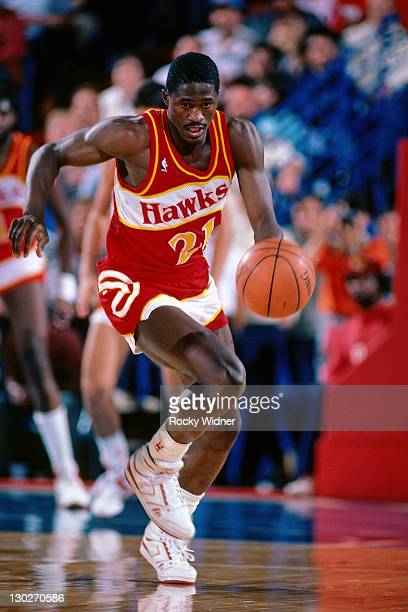 Dominique Wilkins of the Atlanta Hawks drives against the Sacramento Kings on November 30, 1986 at Arco Arena in Sacramento, California. NOTE TO...
