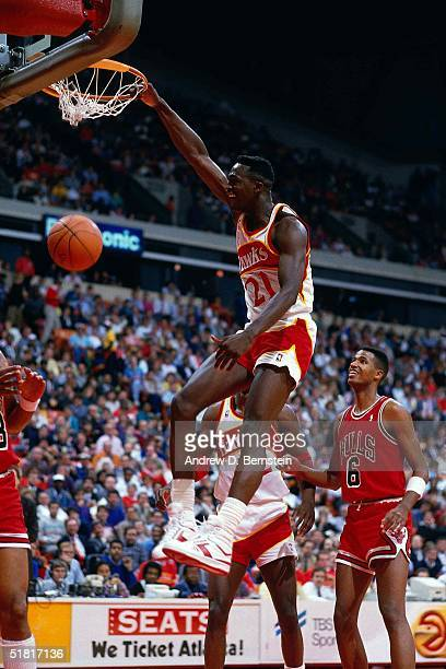 Dominique Wilkins of the Atlanta Hawks dunks against the Chicago Bulls during the NBA game in Atlanta Georgia NOTE TO USER User expressly...