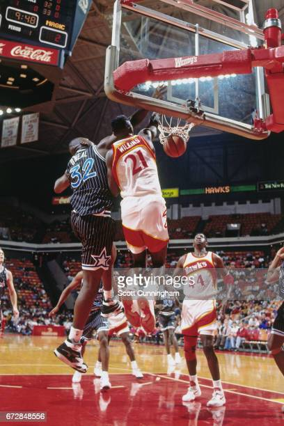 Dominique Wilkins of the Atlanta Hawks dunks against the Orlando Magic during a game played circa 1990 at the Omni in Atlanta Georgia NOTE TO USER...