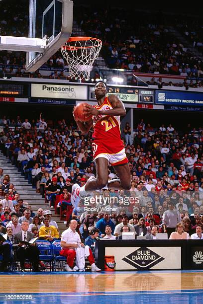 Dominique Wilkins of the Atlanta Hawks dunks against the Sacramento Kings on January 16, 1990 at Arco Arena in Sacramento, California. NOTE TO USER:...