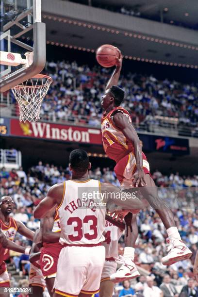 Dominique Wilkins of the Atlanta Hawks dunks circa 1990 at the Summitt in Houston, Texas. NOTE TO USER: User expressly acknowledges and agrees that,...