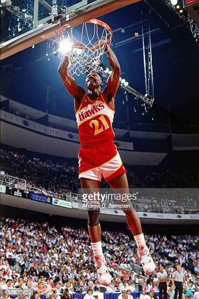 Dominique Wilkins of the Atlanta Hawks dunks during the 1990 NBA All-Star Slam Dunk Contest on February 10, 1990 at Miami Arena in Miami,Florida....