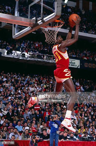 Dominique Wilkins of the Atlanta Hawks dunks during the Gatorade Slam Dunk Championship during the 1988 NBA All-Star Weekend on February 6, 1988 in...