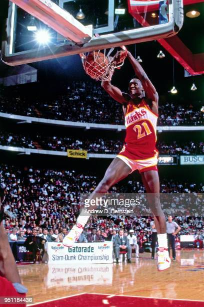 Dominique Wilkins of the Atlanta Hawks dunks the ball during the 1988 NBA All-Star Slam Dunk Contest on February 6, 1988 at the Chicago Stadium in...
