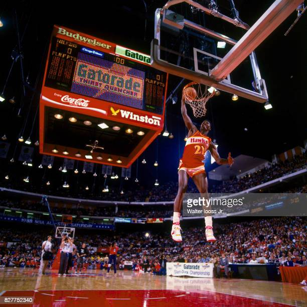 Dominique Wilkins of the Atlanta Hawks dunks the ball during the 1990 Gatorade Slam Dunk Contest played at the Miami Arena on February 10, 1990 in...
