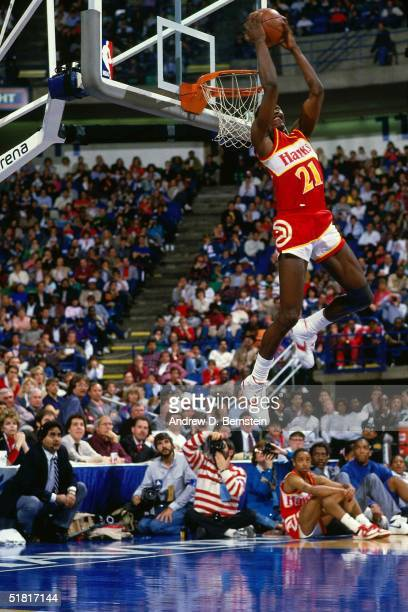 Dominique Wilkins of the Atlanta Hawks goes for a dunk during the Gatorade Slam Dunk Championship during the 1988 NBA AllStar Weekend at Chicago...
