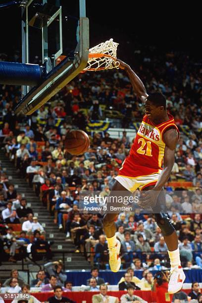 Dominique Wilkins of the Atlanta Hawks goes for a dunk during the Gatorade Slam Dunk Championship during the 1985 NBA All-Star Weekend at Chicago...