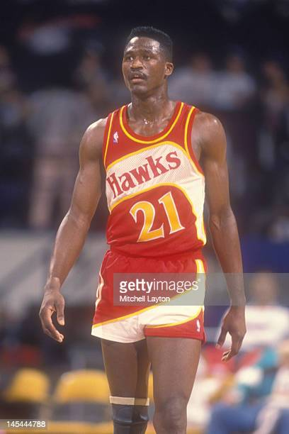 Dominique Wilkins of the Atlanta Hawks looks on during a basketball game against the Washington Bullets at the Capitol Centre on March 24 1988 in...