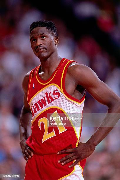 Dominique Wilkins of the Atlanta Hawks looks up at the scoreboard during a game played in 1992 at the Veterans Memorial Coliseum in Portland, Oregon....