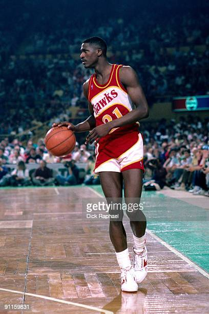 Dominique Wilkins of the Atlanta Hawks moves the up court against the Boston Celtics during a game played in 1987 at the Boston Garden in Boston,...