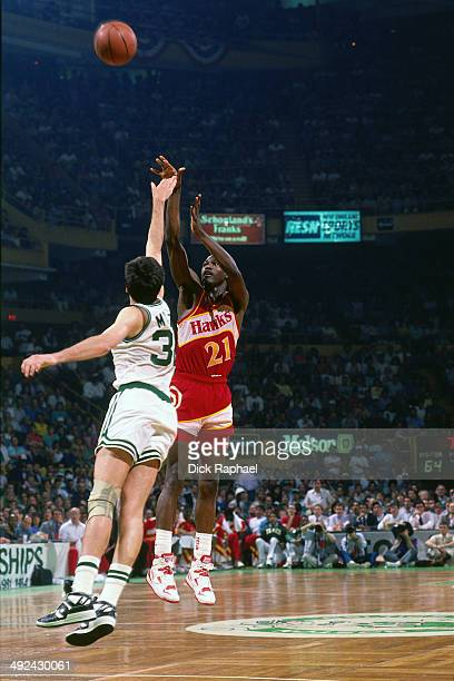 Dominique Wilkins of the Atlanta Hawks shoots against Kevin McHale of the Boston Celtics during a game played in 1988 at the Boston Garden in Boston...