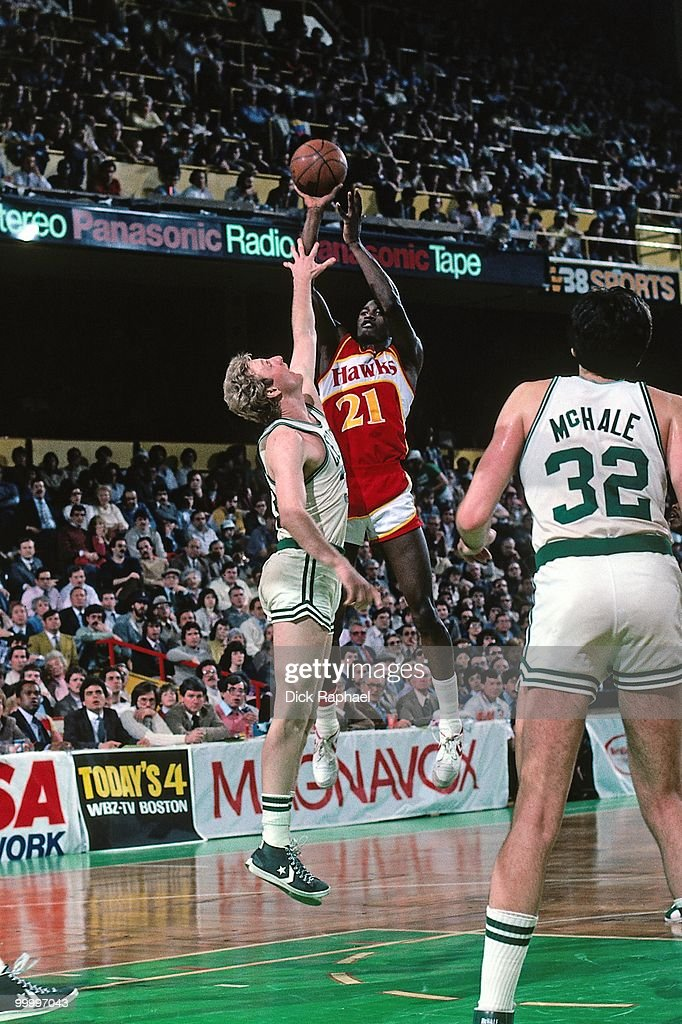 Dominique Wilkins #21 of the Atlanta Hawks shoots against Larry Bird #33 of the Boston Celtics during a game played in 1983 at the Boston Garden in Boston, Massachusetts.