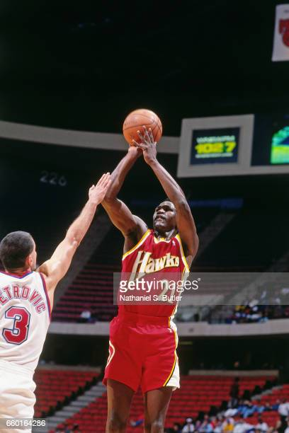 Dominique Wilkins of the Atlanta Hawks shoots against the New Jersey Nets during a game played circa 1993 at the Brendan Byrne Arena in East...