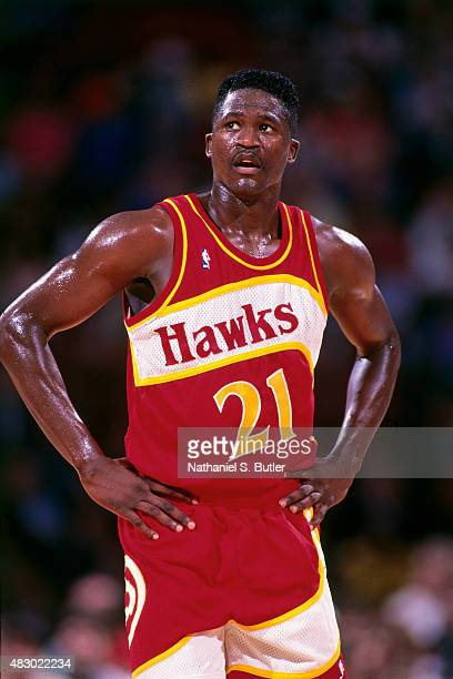 Dominique Wilkins of the Atlanta Hawks stands on the court during a game circa 1991 at The Omni in Atlanta, Georgia. NOTE TO USER: User expressly...