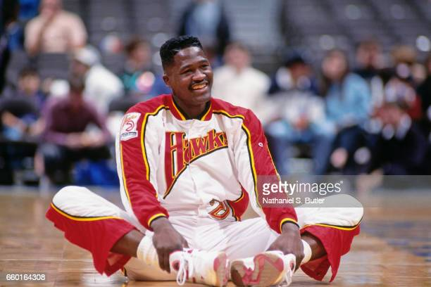 Dominique Wilkins of the Atlanta Hawks stretches against the New Jersey Nets during a game played circa 1993 at the Brendan Byrne Arena in East...