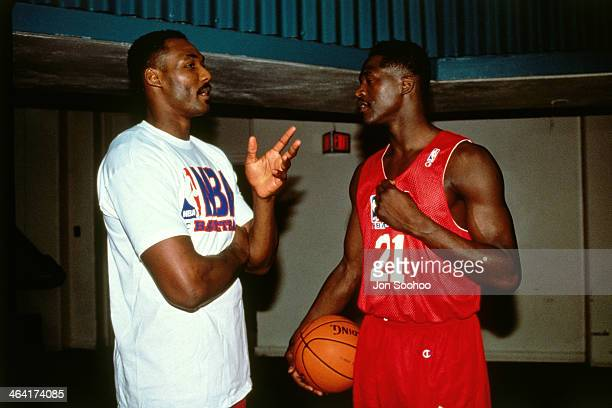 Dominique Wilkins of the Eastern Conference AllStars and Karl Malone of the Western Conference AllStars talk during NBA AllStar Practice as part of...