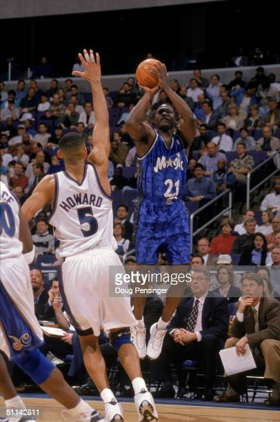 Dominique Wilkins of the Orlando Magic shoots a jump shot over Juwan Howard of the Washington Wizards during the game at MCI Center on March 31 1999...