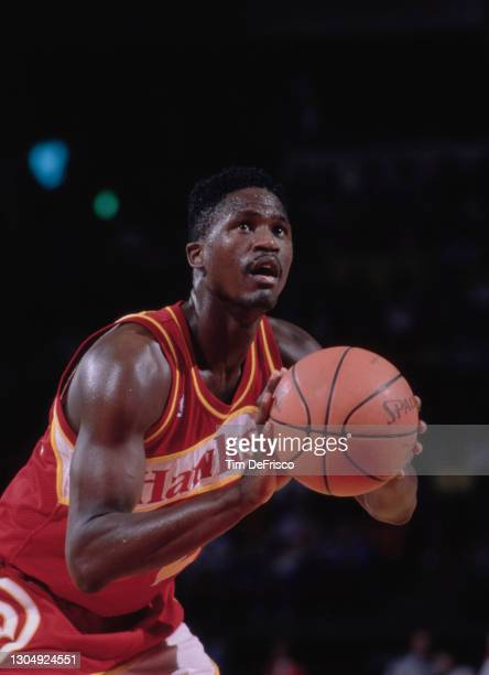 Dominique Wilkins, Small Forward for the Atlanta Hawks attempts a free throw during the NBA Midwest Division basketball game against the Denver...