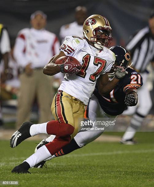 Dominique Zeigler of the San Francisco 49ers runs with the ball after a catch as Corey Graham of the Chicago Bears reaches for the tackle on August...