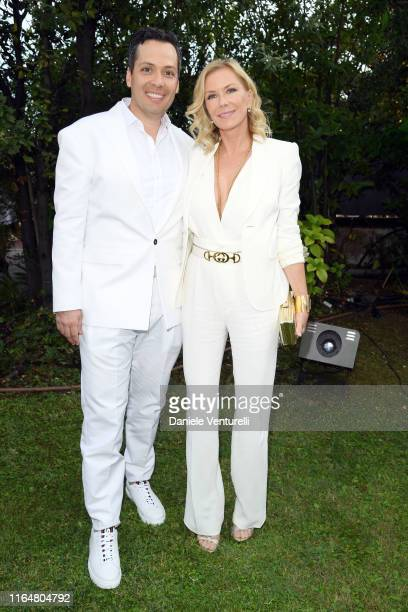 Dominique Zoida and Katherine Kelly Lang pose at the Andrea Bocelli Celebrity Fight Night 2019 on July 28 2019 in Forte dei Marmi Italy