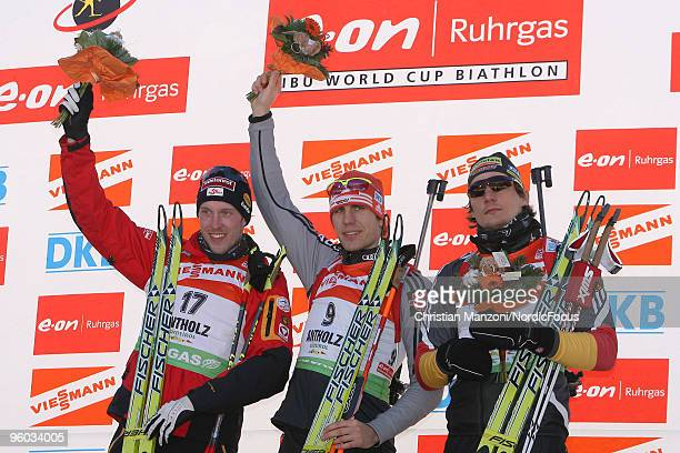 Domink Landertinger of Austria celebrates with Winner Arnd Peiffer of Germany and Christoph Stephan of Germany after the men's sprint in the e.on...