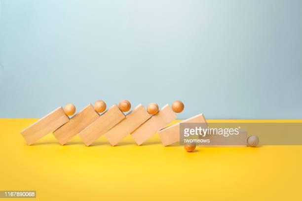 domino effect concept still life. - niederlage stock-fotos und bilder