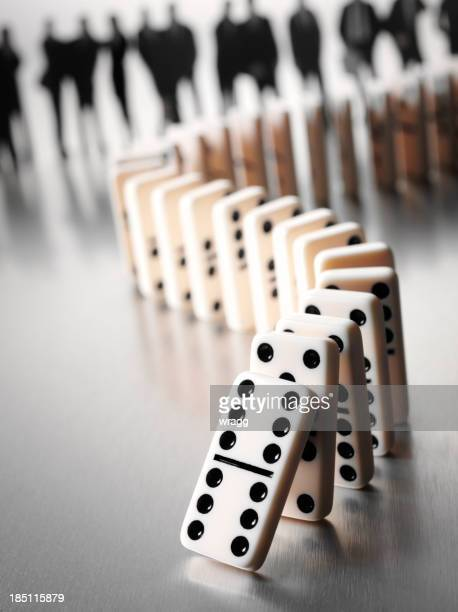 Domino Effect with Dominoes and a Business Team