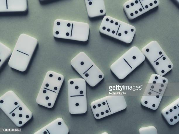 domino pieces isolated on mint background - gambling table stock pictures, royalty-free photos & images