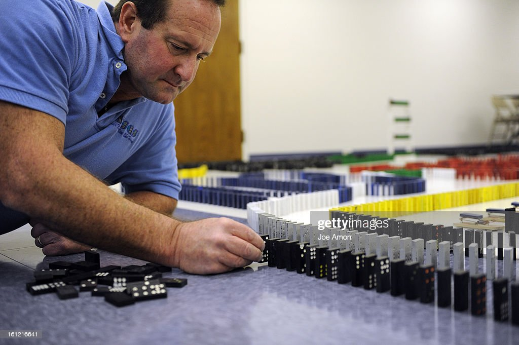 'Domino Wizard' Robert Speca, five-time domino toppling world-record holder setting up his domino's. To put the negative consequences of Prop 103 to the Colorado economy in perspective, the Independence Institute toppled a display of 5,500 dominoes, with each fallen domino representing the loss of 2 jobs in Colorado. Joe Amon, The Denver Post