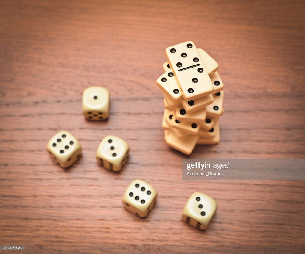 Dominoes And Dice Stock Photo - Getty Images