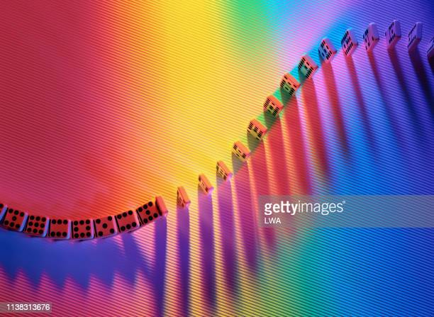 dominoes in coloured light - special:random stock pictures, royalty-free photos & images