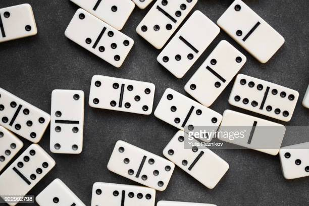 Dominoes on the black background