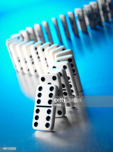 Dominoes with a Domino Effect