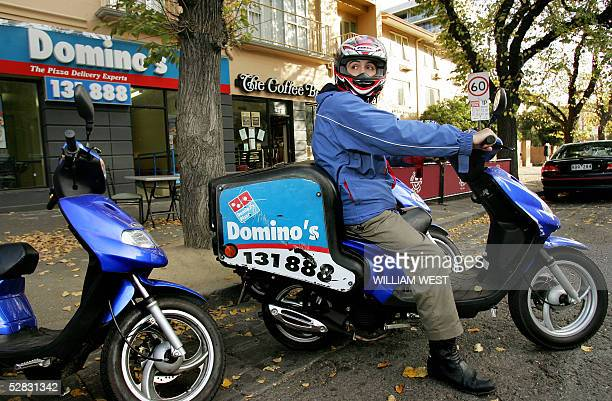 Domino's Pizza delivery boy prepares to speed into the traffic with his order in the pizzasaturated suburb of Carlton in Melbourne 16 May 2005 as...