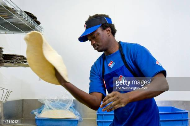 Domino's Pizza manager TJ Djigue creates a hand tossed pizza Monday June 18 2012 in Bethesda MD The FDA is crafting regulations that would require...