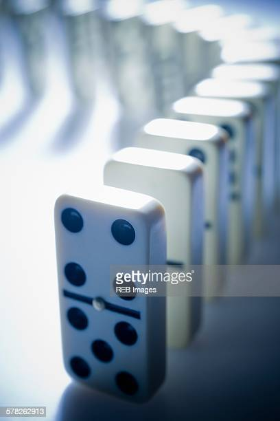Dominos standing in a curved line