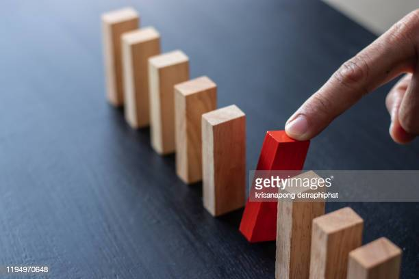 domino,wooden block,business risk, strategy and planing concept idea. - risk stock pictures, royalty-free photos & images