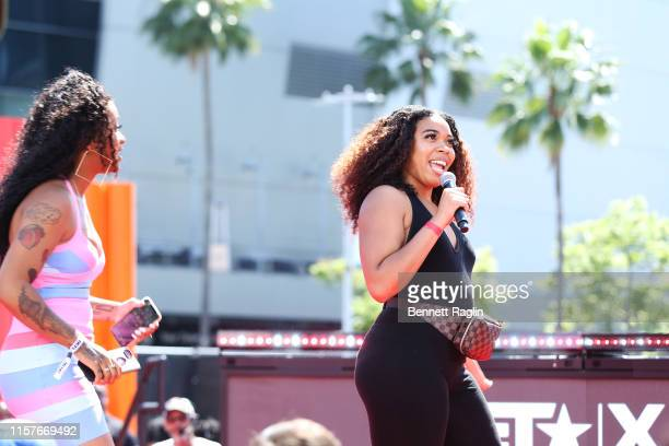 Domo Wilson and guest participate in karaoke contest during BET Experience Live Sponsored By CocaCola at LA Live on June 22 2019 in Los Angeles...