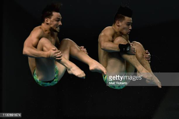 Domonic Bedggood and Declan Stacey of Australia compete during the Men's 10m Platform Synchro Final on day one of the FINA Diving World Cup...