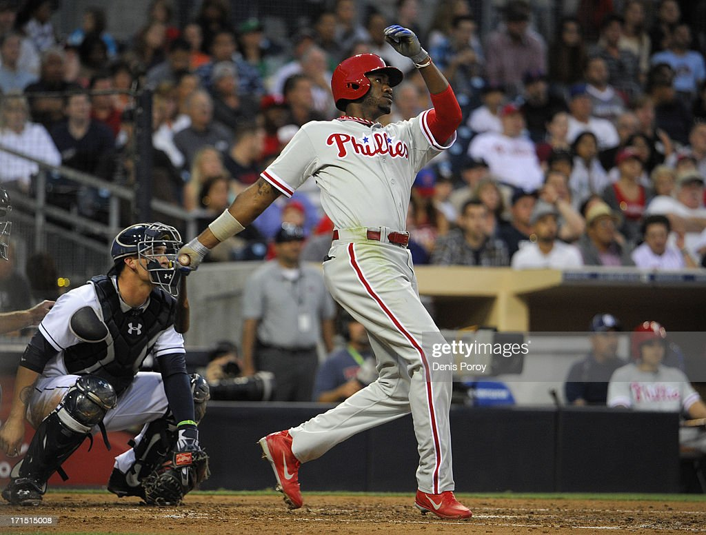 Domonic Brown #9 of the Philadelphia Phillies hits a three-run homer during the third inning of a baseball game against the San Diego Padres at Petco Park on June 25, 2013 in San Diego, California.