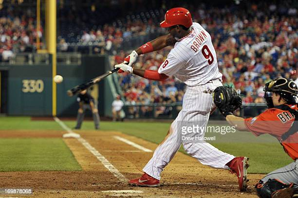 Domonic Brown of the Philadelphia Phillies hits a two run home run in the sixth inning against the Miami Marlins at Citizens Bank Park on June 3 2013...