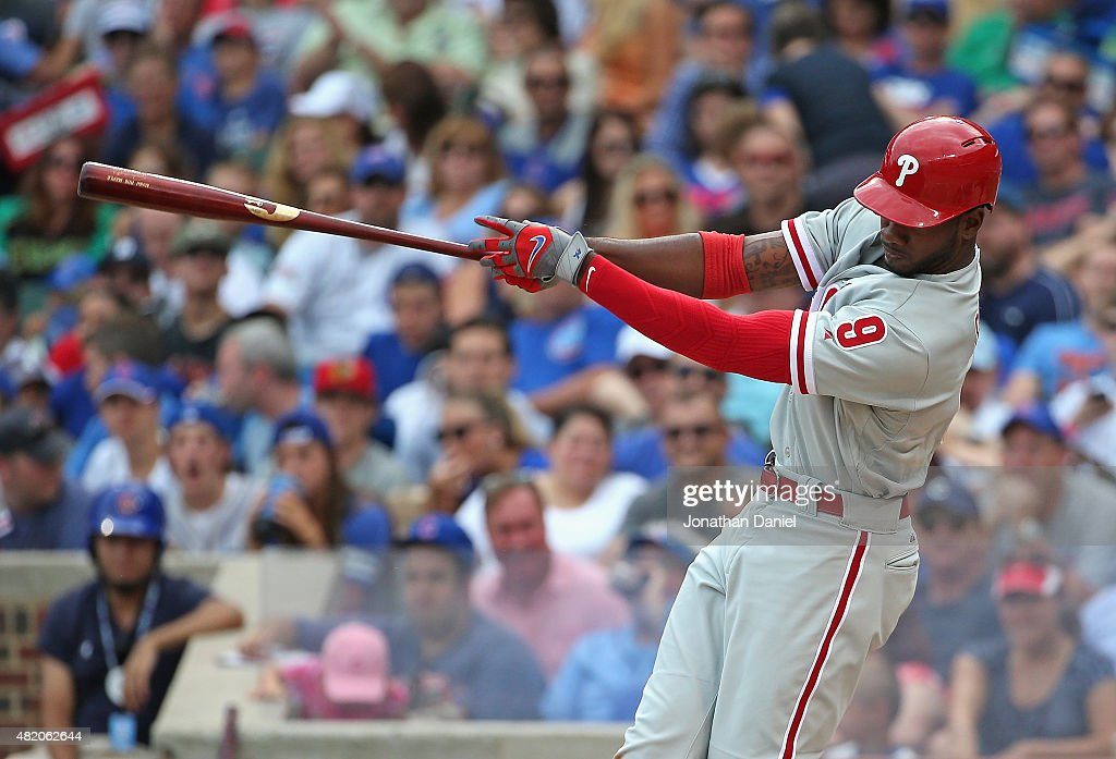 Domonic Brown #9 of the Philadelphia Phillies hits a two-run triple in the 5th inning against the Chicago Cubs at Wrigley Field on July 26, 2015 in Chicago, Illinois.