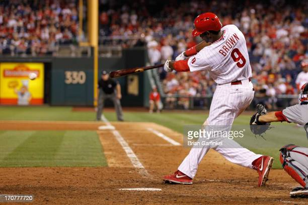 Domonic Brown of the Philadelphia Phillies hits an RBI single in the bottom of the ninth inning to win the game against the Washington Nationals at...